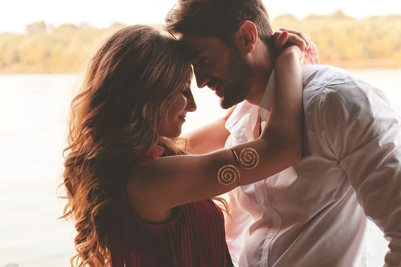 beautiful woman hugging with man