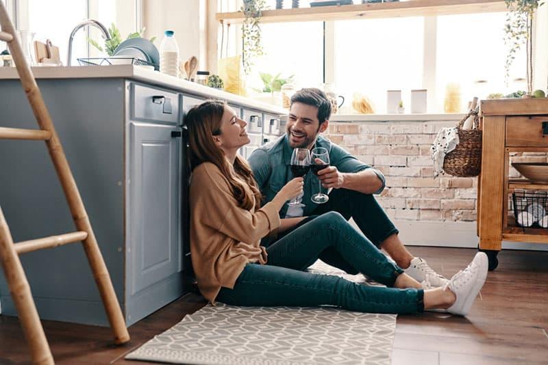 couple drinking wine on the kitchen floor