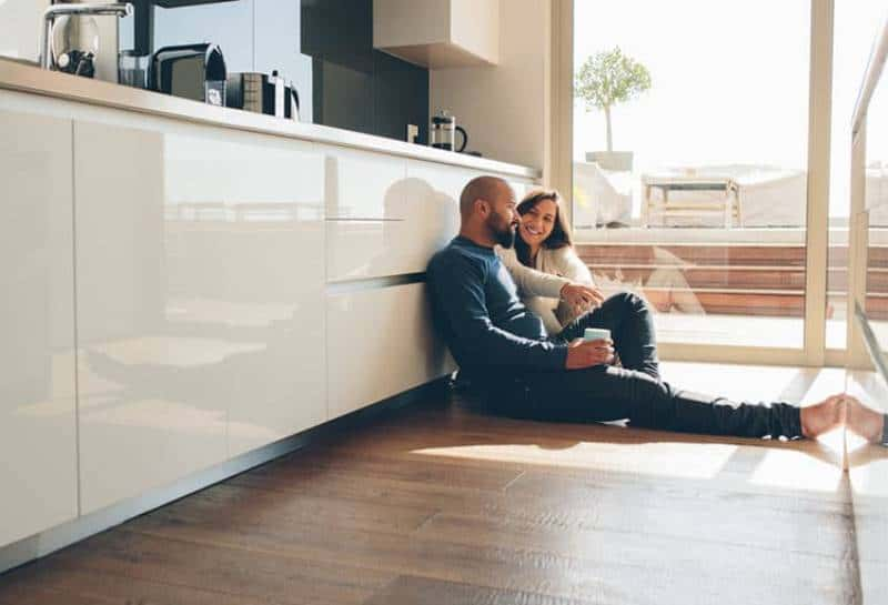 couple sitting in the kitchen at home