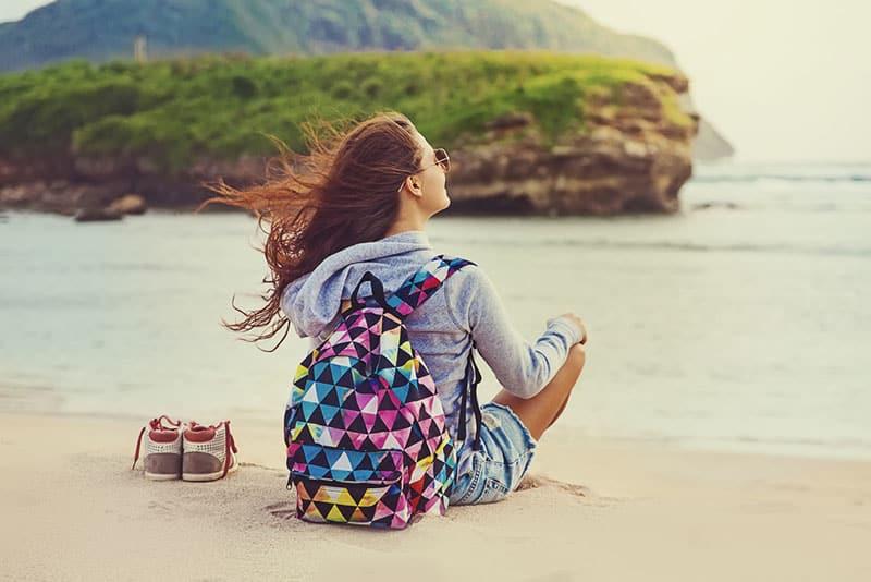 happy woman sitting on the beach