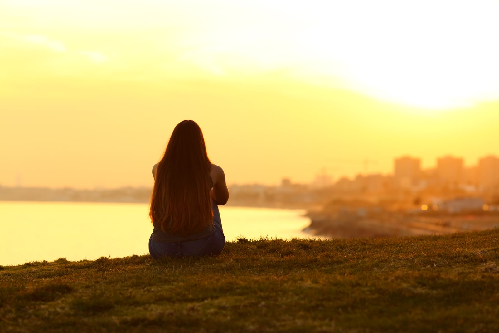 lonely woman sitting on the hill