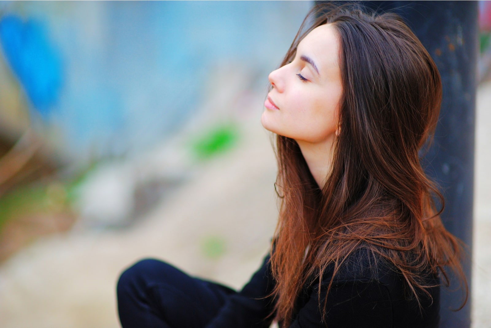 mindful woman sitting with closed eyes