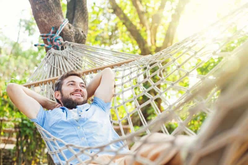 relaxing man in swinging in a hammock