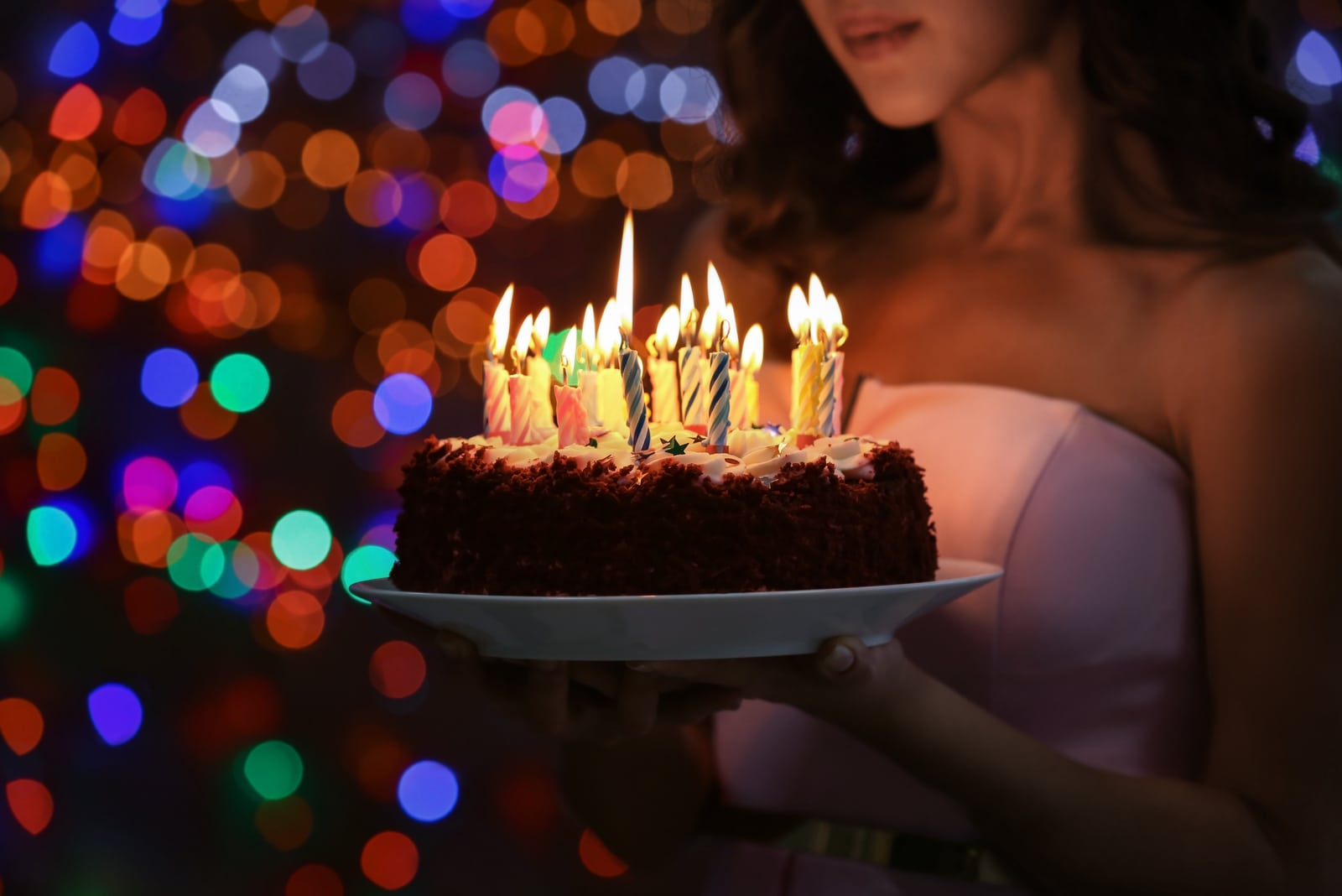 the woman holds the cake in her hand