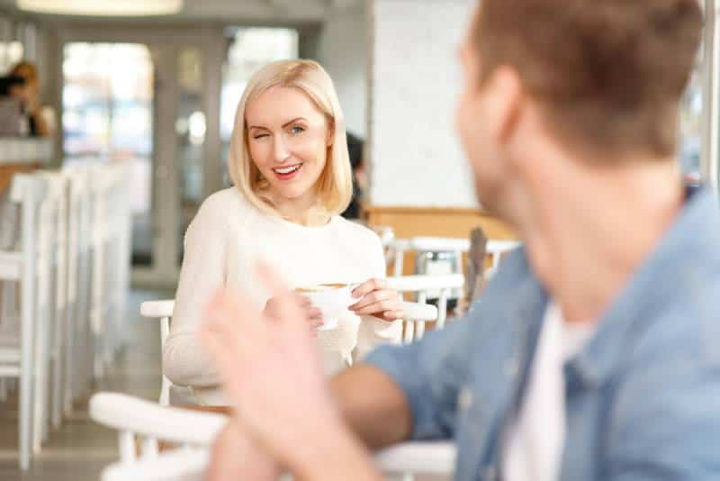 woman flirting with man in coffe bar