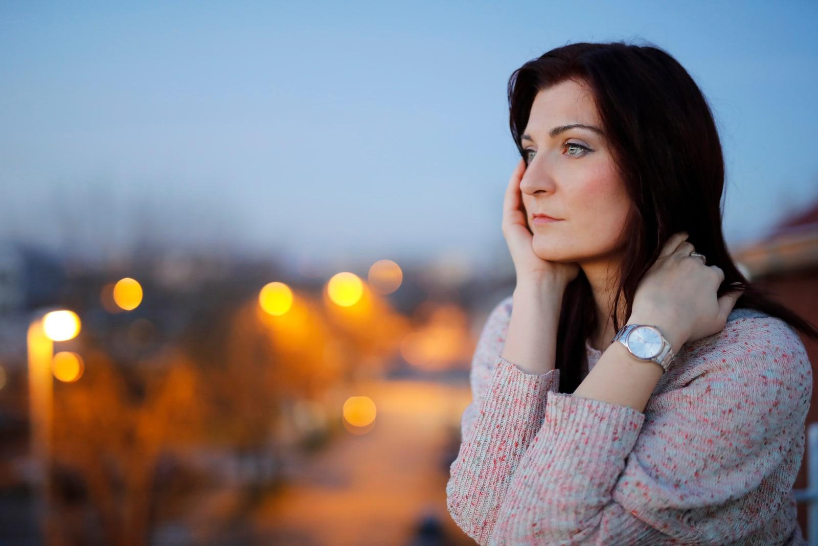 pensive woman on the balcony