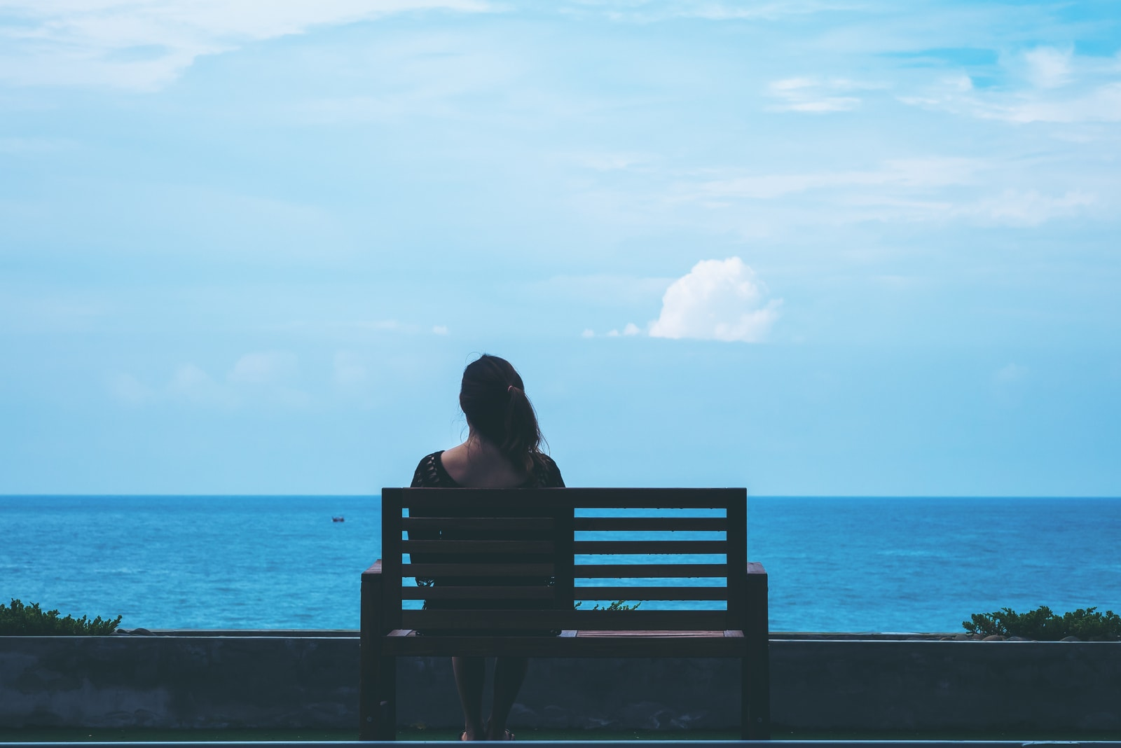 woman sitting on the bench alone