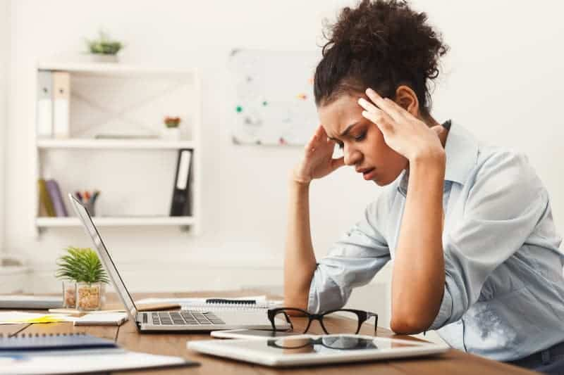 african woman overthinking