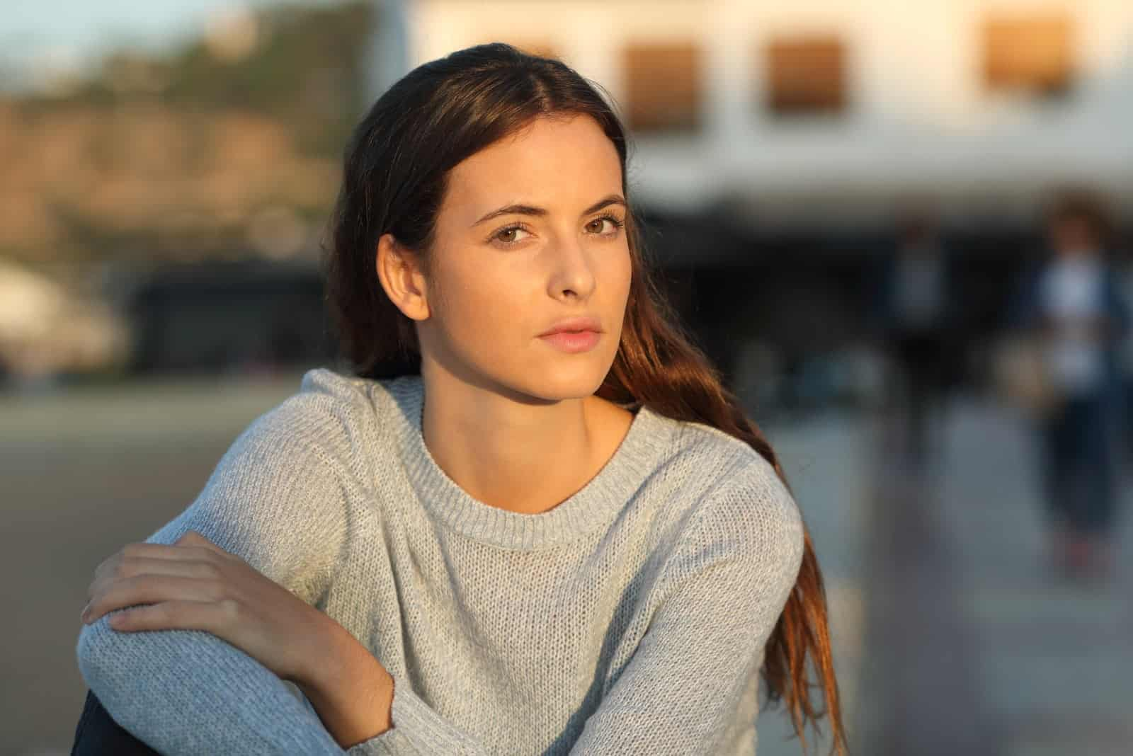 serious young woman sitting outdoor