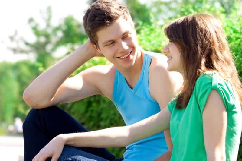 smiling couple talking outside