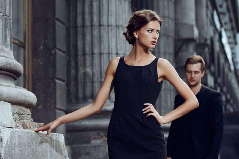 Fashion style photo of a beautiful couple on a city background.