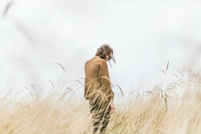 Person standing in the middle of the wheat field