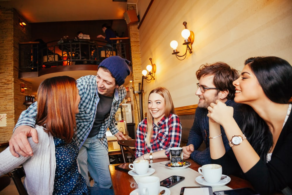 a group of friends hang out in a cafe