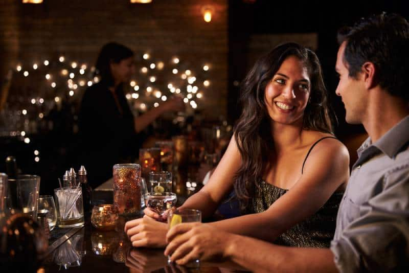 happy couple at cocktail bar