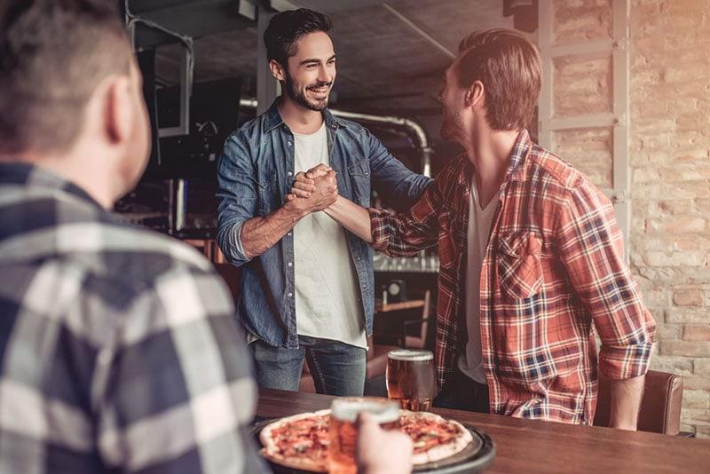 happy men meets at pizzeria