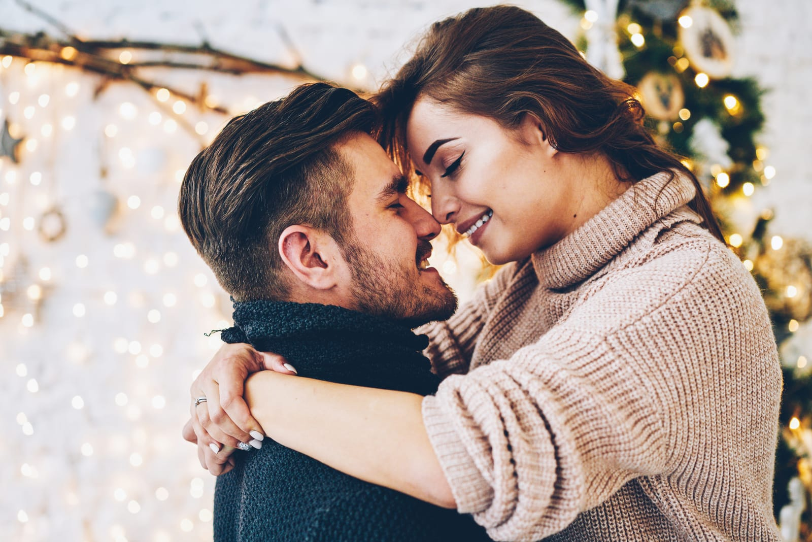 couple wearing sweaters hugging each other