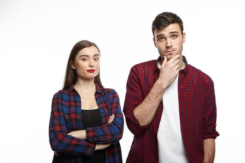 man look thoughtful next woman