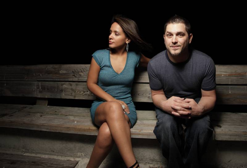 man on the bench next to a beautiful young woman