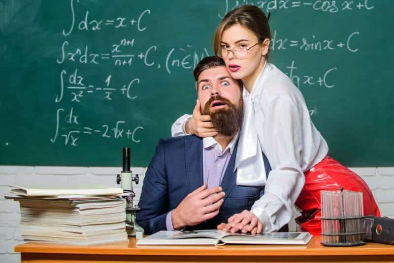 sexy teacher holds man with beard at school