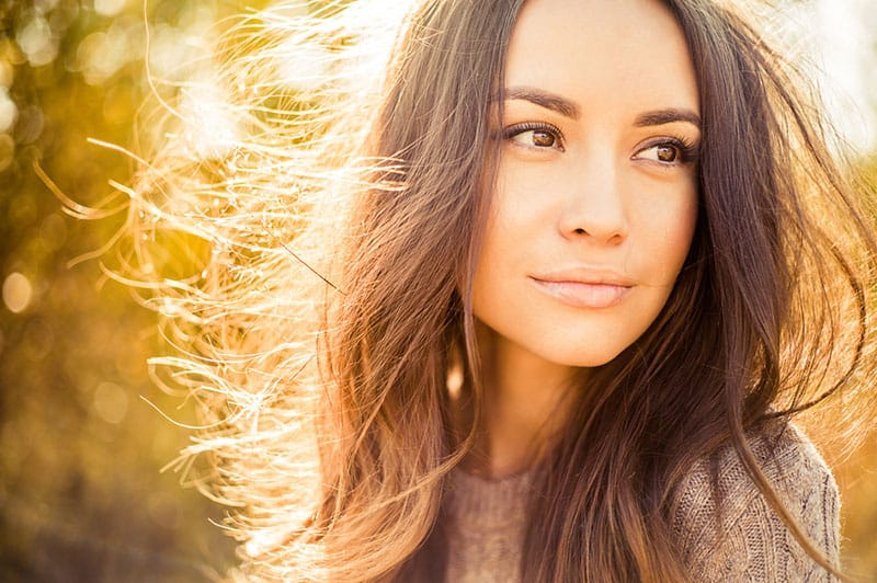 attractive woman looking away in sunlight