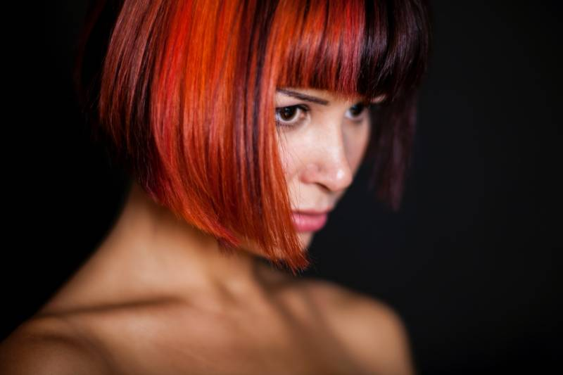 close up photo of woman with red short hair