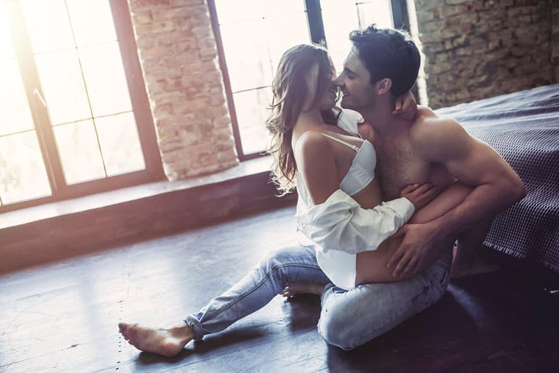 couple kissing passionate on the floor