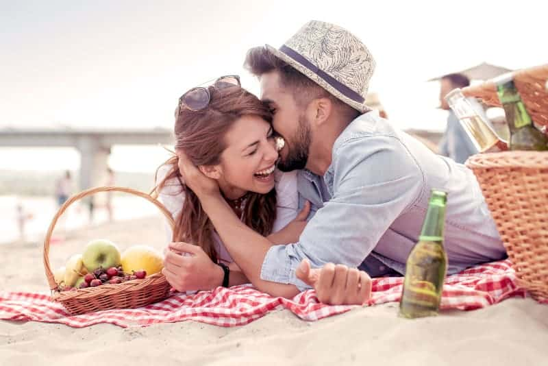 happy couple having picnic
