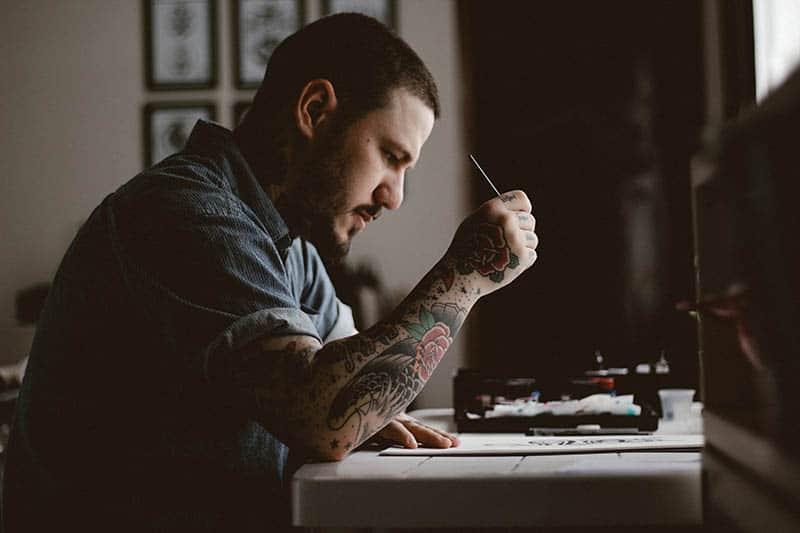 man writing something down