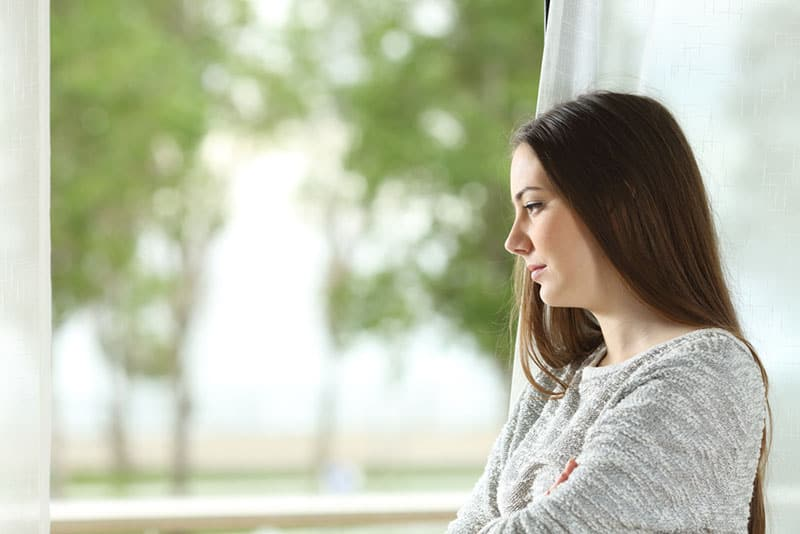 mindful woman looking through the window