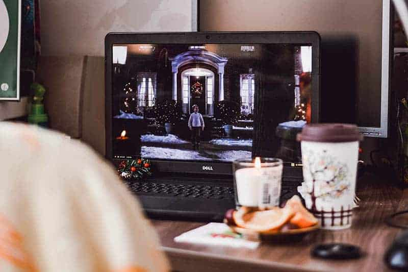 photo of laptop beside candles