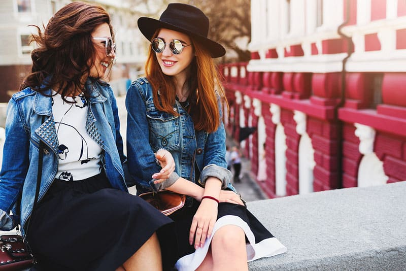 two stylish woman talking outdoor