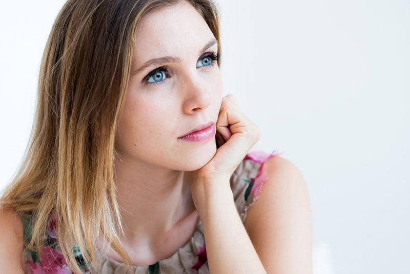 worried woman with blue eyes