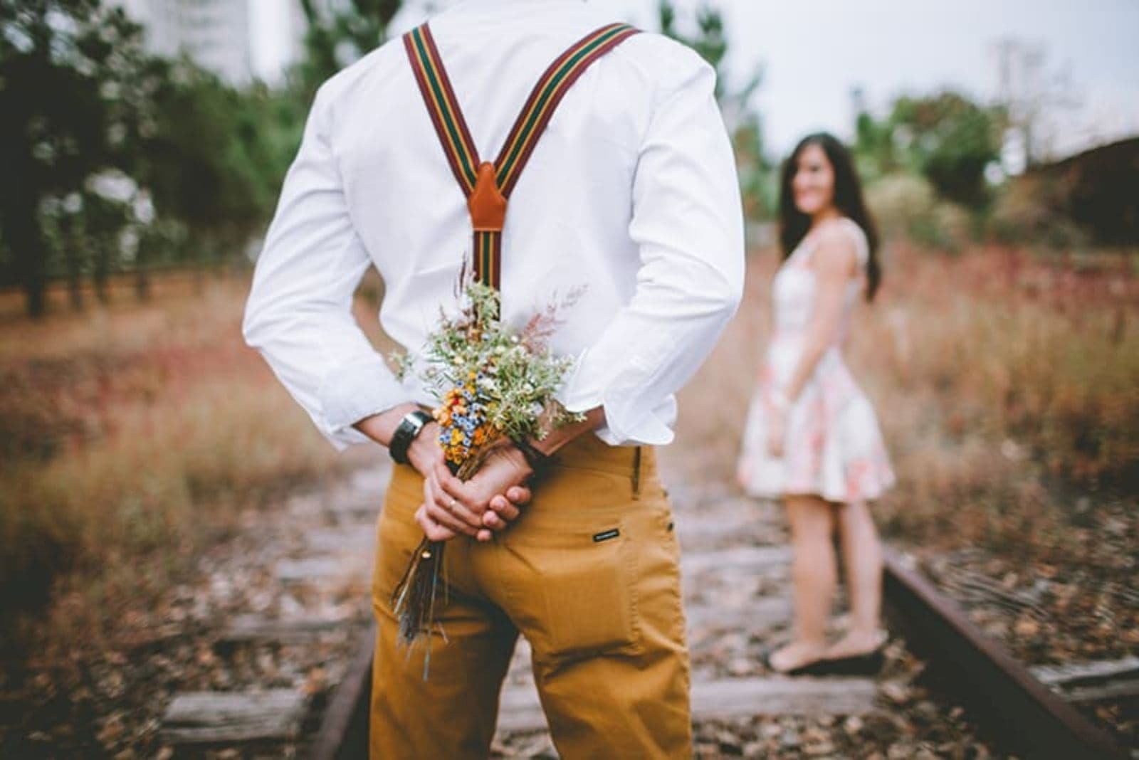a man bought a bouquet of roses for a woman