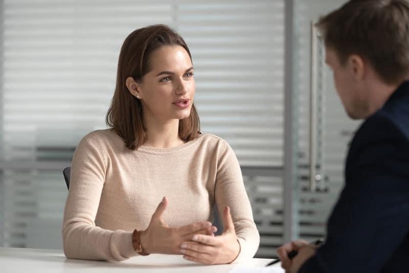 calm woman talking to man