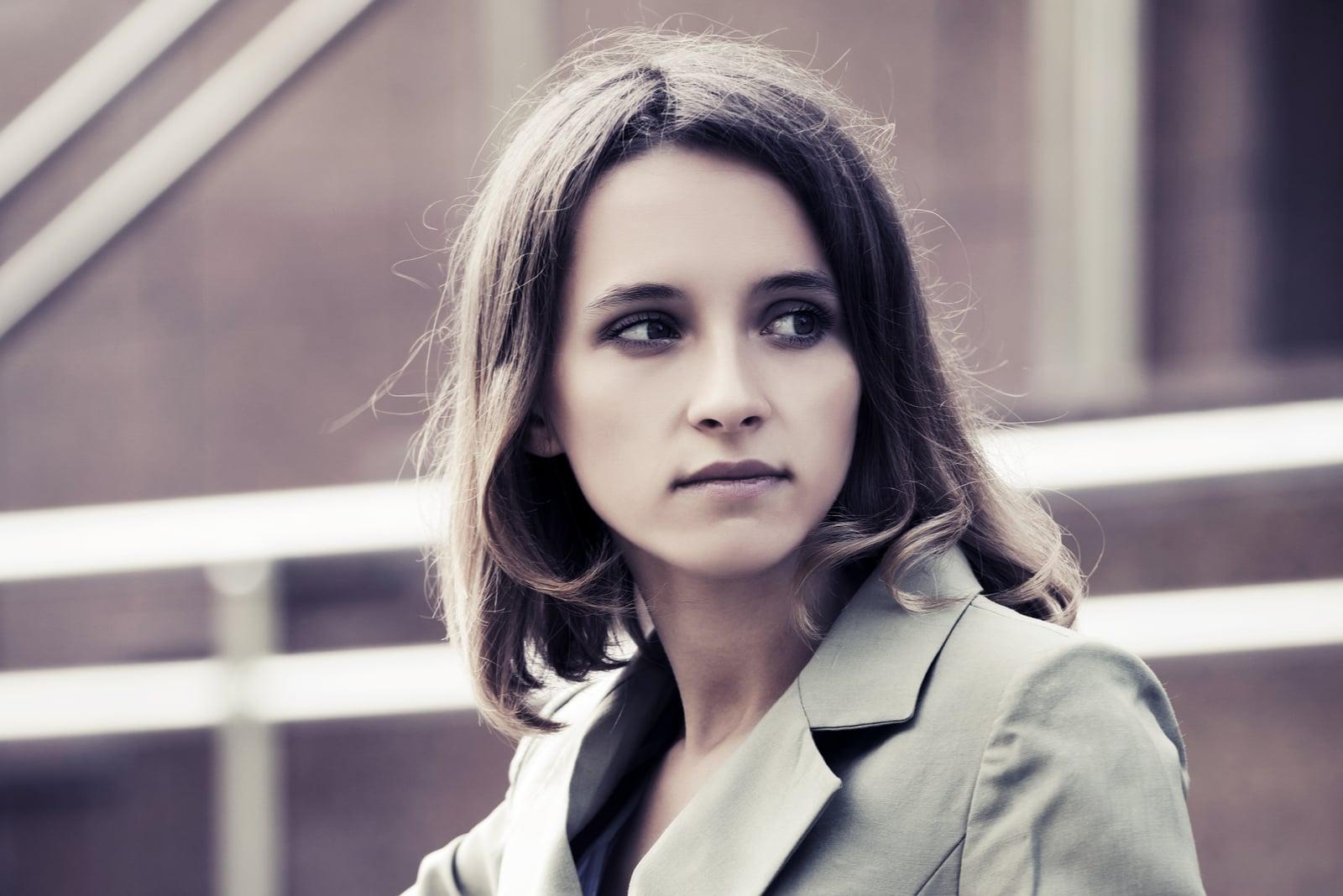 fashion woman in gray blazer looking away