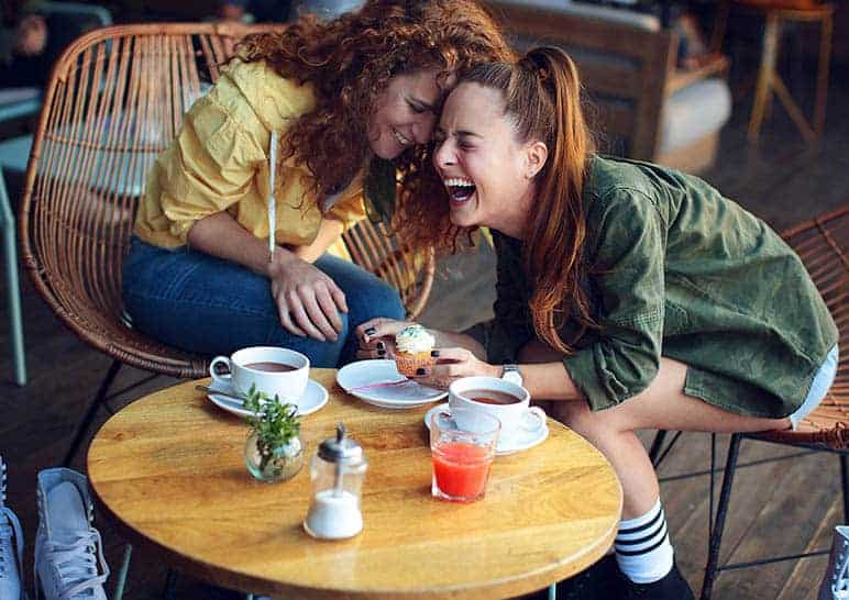 friends laughing together on coffee time
