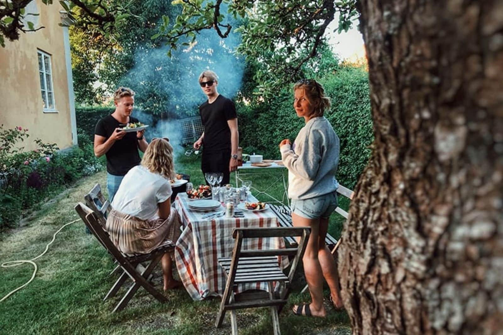 friends stand and grill