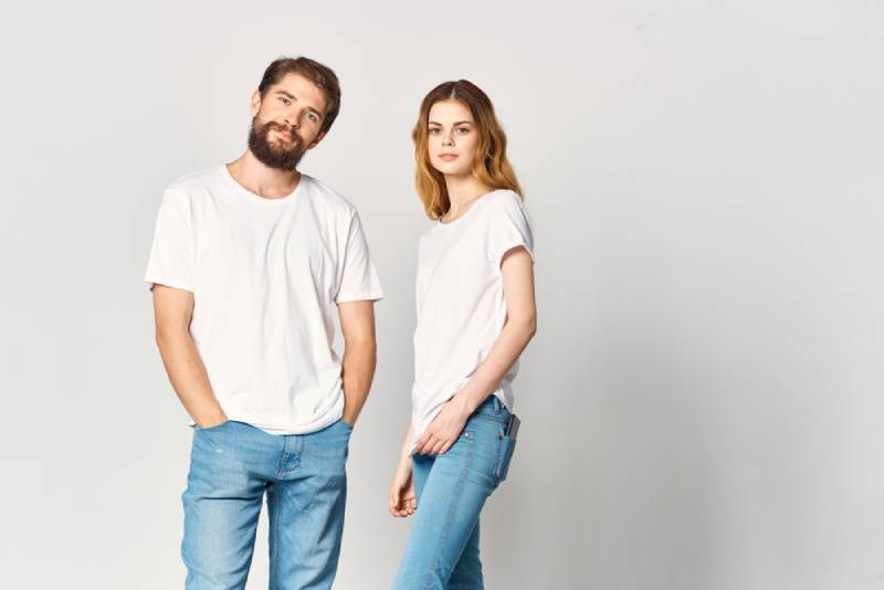 man and woman wearing same outfit with white background