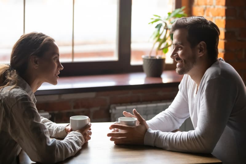 smiling couple talking in cafe