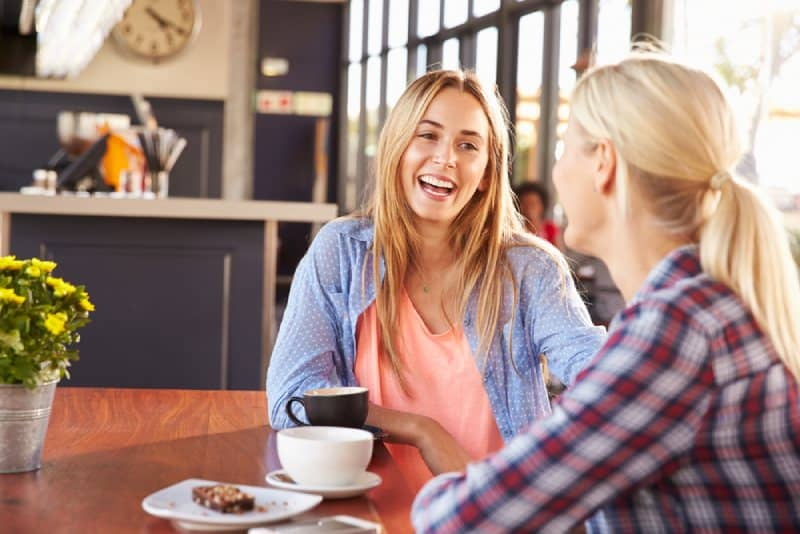 two female friend enjoying on coffe at cafe