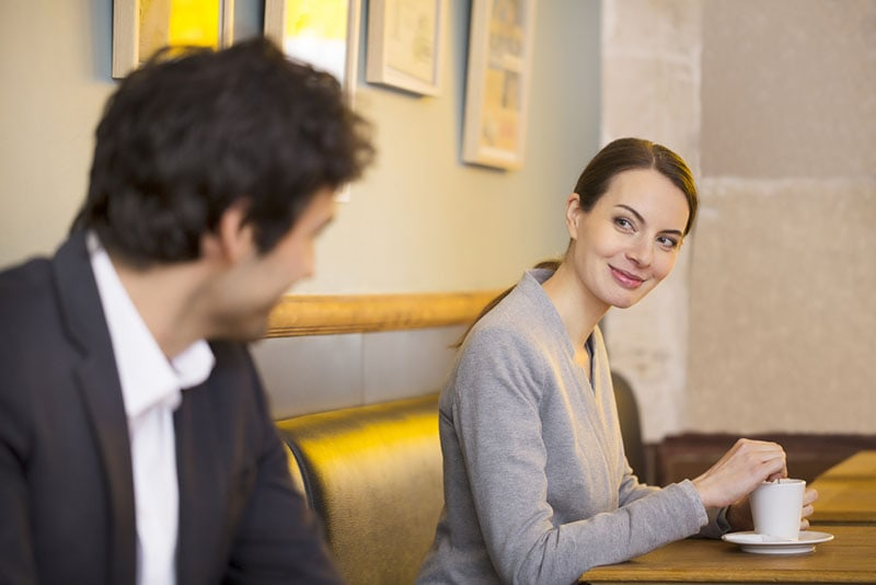 woman flirting with man at cafe
