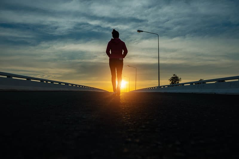 woman walking on the road