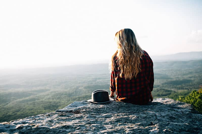 young woman sitting in nature