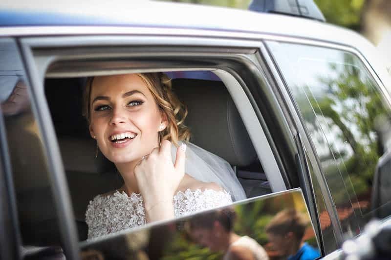 bride sitting in the car
