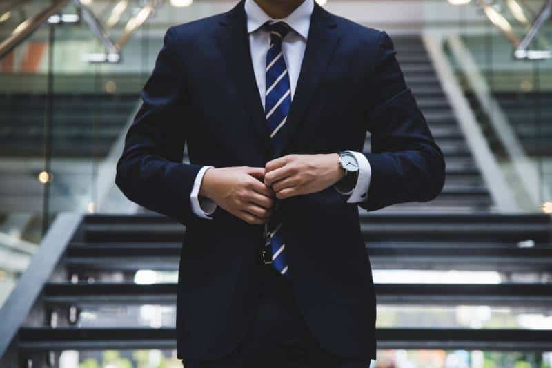 business man standing near the stairs