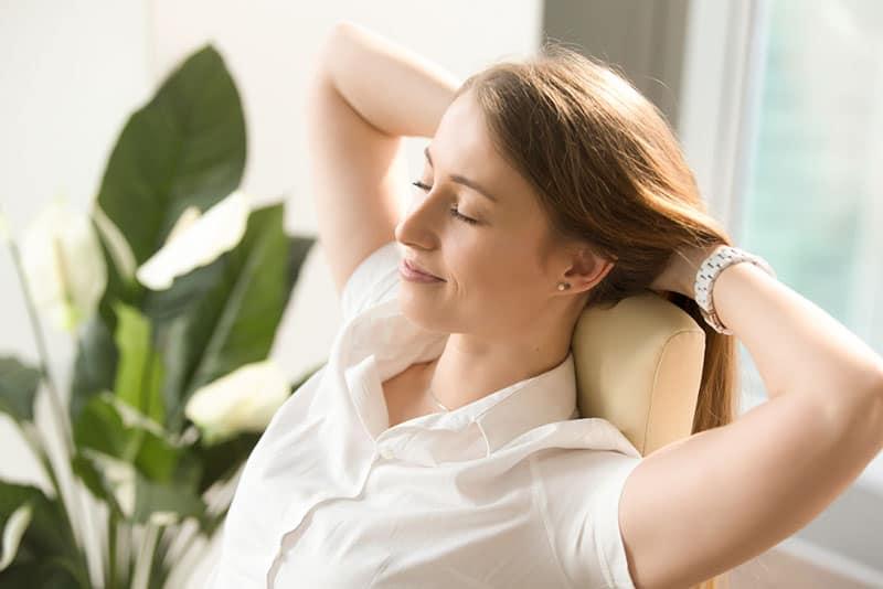 calm woman sitting in chair