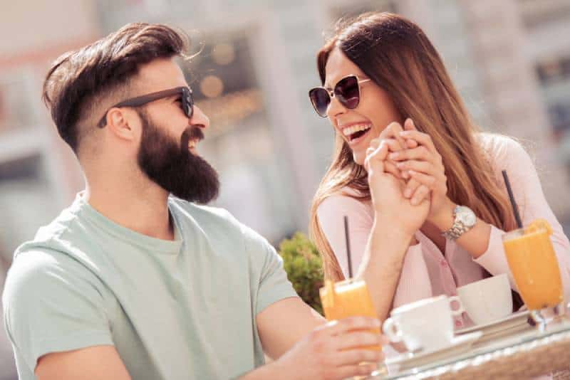 cheerful couple having a date in cafe