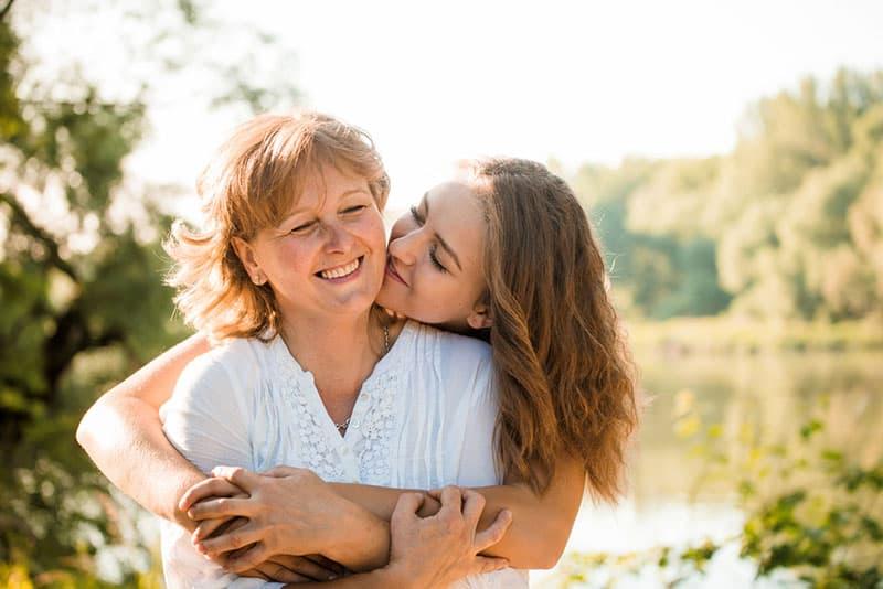 daughter hugging her mother outdoor