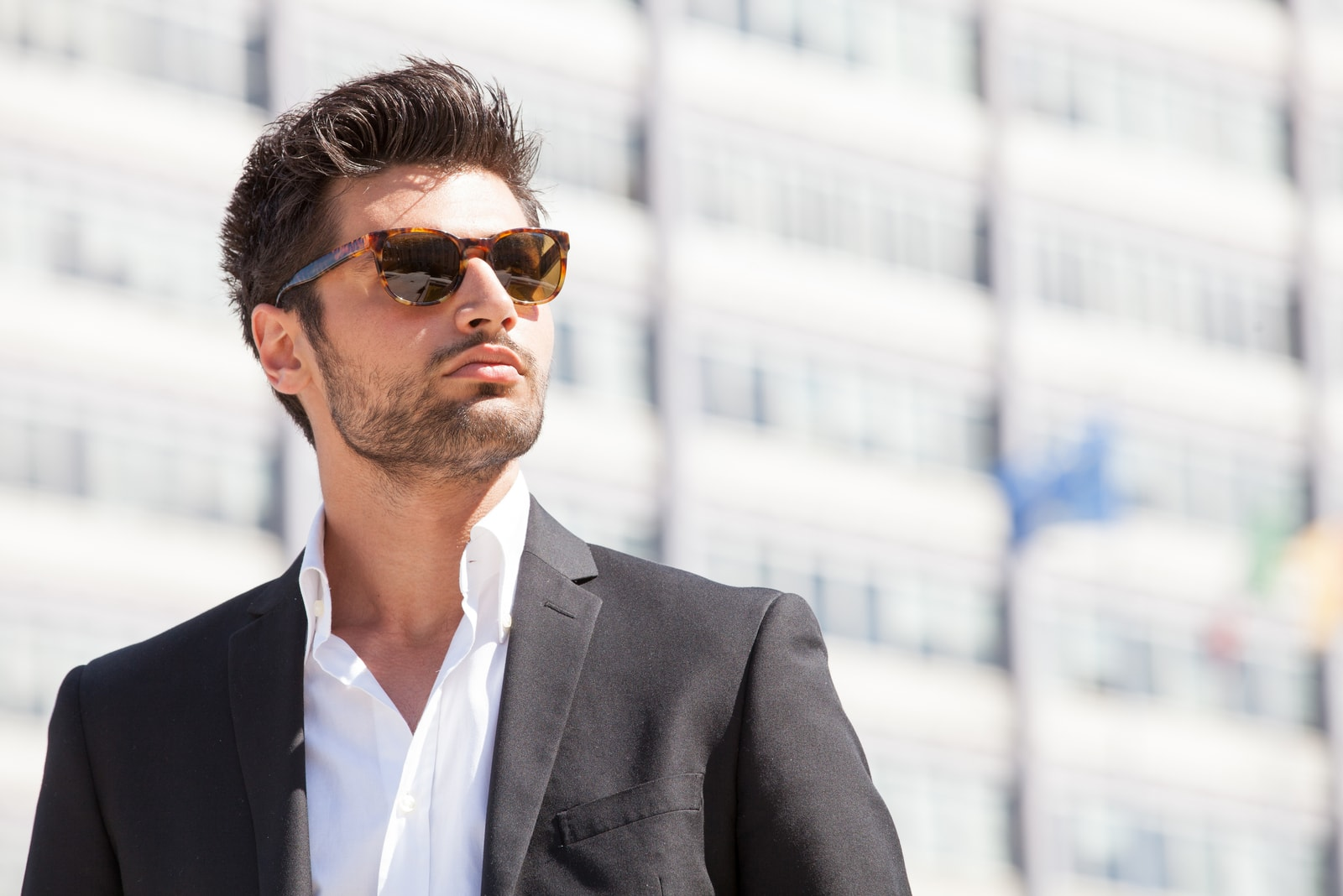 handsome man in suit wearing sunglasses