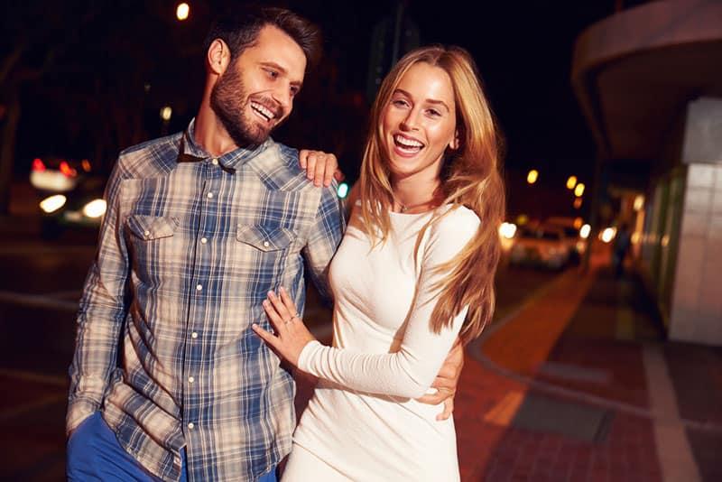 happy couple walking at night